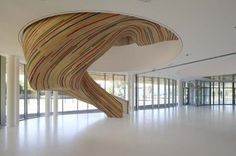 Great stair for the School of Arts comprised of laminated timber. Some of the timber strips have been painted adding extra dynamics. Via Tetrarc Architects