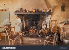 interior of an old country house where a dog gets hot inside the fireplace