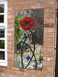 Mosaic garden mirror (62 x 123cm / 2' x 4'). Designed and handmade using stained glass and recycled mirror.