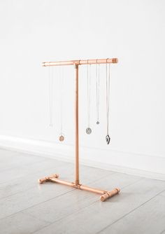 Copper pipe necklace display