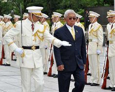 Philippine Defence Minister Voltaire Gazmin (R) reviews the honor guards at the Defence Ministry in Tokyo on July 2, 2012. Gazmin and Morimoto exchanged documents on the defence cooperation between both countries.