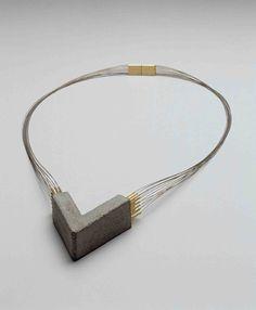 Tasso Wilhelm Mattar_necklace, concrete, gold, steel strings, 1985 Schmuckmuseum Pforzheim, Germany