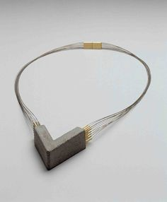 Tasso Wilhelm Mattar_necklace, concrete, gold, steel strings, 1985 Schmuckmuseum Pforzheim, Germany