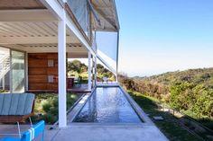 Fachada y diseño de casa moderna en la colina estilo origami | Construye Hogar