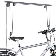 Kettler Spezi Bicycle Lifter by Kettler. $68.01. Dimensions: 38 by 1 by 4 inches. Weight Limit: 55 pounds. Sturdy powder-coated steel construction. Stores any bicycle safely off the ground. All hardware included. Amazon.com                Lift any of your bikes off the floor to make room in the garage or your apartment. With a strong powder-coated steel frame, the Spezi can lift and hold bikes up to 55 pounds and fits most any bike.  Features & Specifications: ...