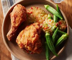 What's the secret to juicy, tender fried chicken? With light, crispy skin, it's a decadent treat that's worth trying, especially served with this delicious pepper sauce. Easy Chicken Recipes, Pizza Recipes, Cooking Recipes, Louisiana Fried Chicken, Cast Iron Pizza Recipe, Stuffed Green Peppers, How To Cook Chicken, Stew, Kitchens