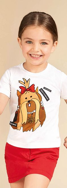 DOLCE & GABBANA Girls White Shitzu Dog Princess Tshirt Spring Summer 2018. This cute t-shirt by Dolce & Gabbana is inspired by the adults collection, with a crowned dog print. Perfect Streetwear Look for a little princess at the beach or on vacation. Pretty Summer Look for a stylish kid, tween and teen girls.    #dolcegabbana #girlsdresses #kidsfashion #fashionkids #childrensclothing #girlsclothes #girlsclothing #girlsfashion