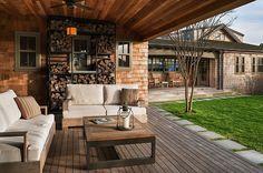 Beach style porch has ample space for firewood storage [Design: Sandvold Blanda Architecture + Interiors]