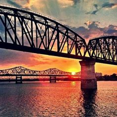 Louisville, KY and its Ohio River bridges at sunset.