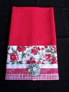 A decorative tea towel for the modern red and white kitchen. This towel is a vibrant orange red colour. I have decorated it with carnation print fabric, lace, complimenting trims and a yo-yo puff. Red And White Kitchen, Carnations, Tea Towels, Floral Tie, Printing On Fabric, Compliments, Vibrant, Color, Yo Yo