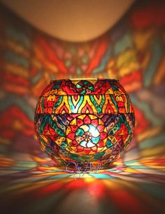 """The Candlestick color mosaic """"Kaleidoscope"""". Stained glass painting."""