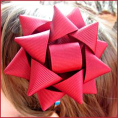 Make your own giant ribbon gift bow hair accessory with free instructions from our blog!    Cassie attached her bow to one of our narrow metal headbands to make a great holiday festive look for little through big girls!