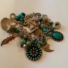 Old Pawn Sterling/Turquoise Charm Bracelet Vintage Sterling Silver toggle clasp charm bracelet. Tons of charms weight is 94.7 grams. Most charms are marked, all stones are real. 30 or more charms, Navajo, fetish, and Zuni  charms Vintage Jewelry Bracelets
