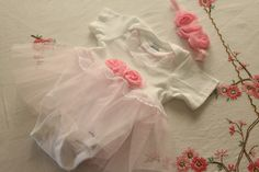 Tutu Onesie.  I will be making this for a new little one that will soon be here in our family