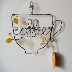 Coffee - wire decoration -- CUTE -- and I THINK I could make this!  Let's see, one in English for my home in Florida, and one in Spanish for my home in GUatemala.  Yep!