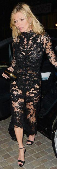 Kate Moss wearing a black lace Alexander McQueen dress