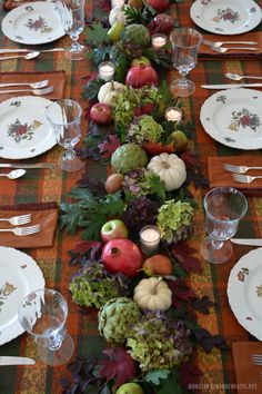 Love this (minus the artichoke and hydrangea)! Fall table with natural table runner using hydrangeas, artichokes, leaves, pomegranates, pears, white pumpkins, apples and votives | homeiswheretheboatis.net