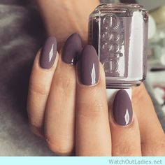 Shiny stiletto nails in taupe color