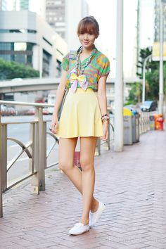 Printed blouse + pastel yellow skirt + chain with ribbon necklace + arm candy + Keds sneakers.
