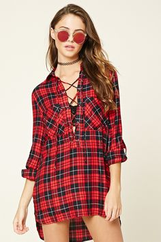 A longline woven shirt featuring a plaid print, lace-up front, basic collar, long rolled-cuff sleeves, dual chest pockets, and a high-low hem.