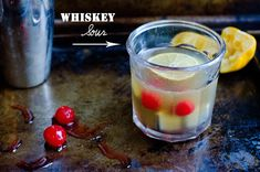 Whiskey Sour:  2 ounces blended whiskey (two shots)  1/4 ounce simple syrup (quarter shot)  Half a lemon (officially ¾ ounce of fresh lemon juice)  Maraschino cherry (or two)