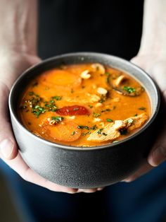 ThisSlow Cooker Thai Chicken Soup is loaded with creamy coconut milk, peanut butter, red curry paste, chicken, and veggies: onion, carrots, bell pepper, mushrooms, and broccoli! PACKED with flavor and healthy deliciousness!Less than 250 calories per cup! showmetheyummy.com #crockpot #chickensoup
