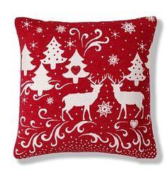 chenille reindeer cushion from http://www.marksandspencer.com love a bit of christmas sofa dressing!
