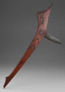 A FINE WESTERN GREAT LAKES GUNSTOCK CLUB - c. 1850, maple wood, hand-forged steel, Height: 27 inches. Gunstock clubs - so called because they resemble a European gunstock - were employed in tribal warfare from the region of the Upper Great Lakes west to the Missouri River. A flint or horn spike might be inserted at the striking corner, replaced by a metal knife blade after their introduction by the fur traders.