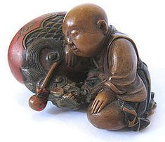"""Wonderful antique Japanese netsuke of a monk fast asleep on a temple bell, carved of boxwood with painted details, Meiji Period, signed: Kyusai (1879-1938). He carved this netsuke between the ages of 36-49,well-known for carving mokugyo, temple bells, in various themes. Size: 2 1/8"""" // - Maria Elena Garcia - ► www.pinterest.com... ◀︎"""