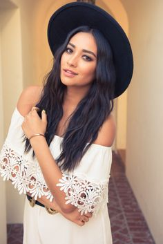 Shay Mitchell is a total fashionista in her white boho dress and black hat