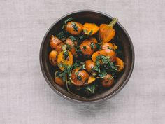 Moroccan Carrots with Aleppo Pepper and Mint | The dressing for this cumin-spiced salad is made from the carrots' cooking liquid, which concentrates into a sweet syrup when reduced.