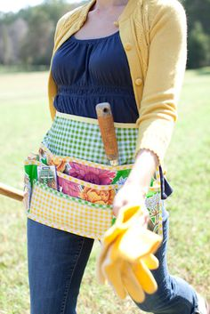 Oilcloth garden apron requires 3 cuts of oilcloth 1/2 yard each, thread,1 pkg 1/2'' double-fold bias tape,clear ruler, craft paper, pencil, tracing paper, smooth edge tracing wheel, press-on snaps