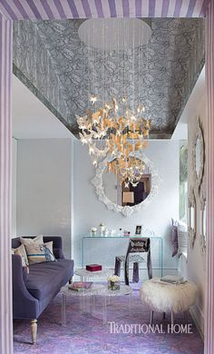 Lladró's cascading butterfly-fairy chandelier lures eyes to the dome ceiling. - Photo: John Bessler / Design: Lonni Paul