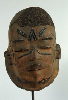 """Mozambique and Tanzania; Makonde peoples Mask Wood, beeswax, hair H. 25.4 cm (10"""") The University of Iowa Museum of Art, The Stanley Collect..."""
