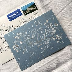 As I think most of my cards should have arrived by now, here's my Christmas mail from 2014! I had the card printed on very beautiful cardboard with a pearly surface. The envelope is of finest handmade paper by Artoz – called Rondo – it was a joy to write on these! #christmas #card #calligraphy #caligrafía #kalligrafie #copperplate #anglaise #inglesa #englishroundhand #flourished #blue #silver #white #linen #rondo #artoz #handmadepaper #flourishforum #federflugcalligraphy