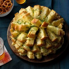 Party Cheese Bread Recipe -You can't go wrong with this recipe. It looks fantastic and people just flock to it! It's great with pasta, too. Cheesy, buttery and finger-licking good, this bread is hard to beat. It's so simple and the taste is sinful! —Karen Grant, Tulare, California