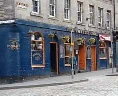 "World's End, where Kendra caught up with Trick in Scotland. A sign reads:""This historic pub stands on a site dating to the 7th century. Its name derives from the Battle of Flodden in 1513, when the Scots were beaten back by the Auld Enemy at Flodden Field, whereupon the Burghers of the City decided to erect a wall separating Edinburgh from the rest of the world. The remains of the wall pass through the cellars below the pub, and the road outside marks where the city ended—Thus, The World's…"