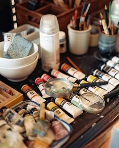 Details Photo - Art supplies and magnifying glasses arranged on a desk