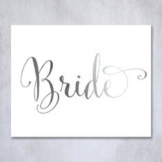 Bride Silver Foil Poster Sign Art Print Wedding Reception Seating Signage Bridal Shower Brunch & Bubbly Poster Decor 8 inches x 10 inches. Digibuddha(TM) real foil art prints are made by hand in our small shop just outside of Philadelphia. • Made with gorgeous luxe silver foil and premium pure white matte card stock. • Prints arrive unmatted, ready to be placed in your favorite frame. • Original design: all Digibuddha(TM) paper goods are exclusively created in-house by our design team.