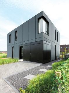 Villa DVT is a black aluminium box which hides a luminous minimalist interior. The modern home is located in Arnhem The Netherlands. Architecture Durable, Houses Architecture, Residential Architecture, Contemporary Architecture, Interior Architecture, Black Architecture, Contemporary Homes, Beautiful Architecture, Minimalist House Design