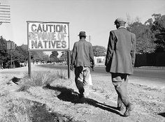 """An image of the actual situation of Apartheid in South Africa. They sign says, """"Caution, beware of Natives"""", which of course refers to the native black people of South Africa. Apartheid Museum, Gil Scott Heron, Cape Town South Africa, African History, African Men, Documentary Film, Photos Du, Black People, Old Pictures"""