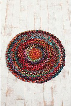 """Fun braided pop of color. UrbanOutfitters.com > 36"""" Round Chindi Braided Rug"""