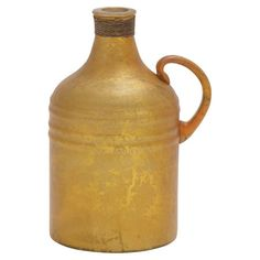 Crafted from glass and featuring a faded gold finish, this classic jug offers warm color for your entryway console table or living room etagere....