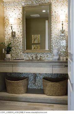 Mosaic tile wall behind bathroom sink