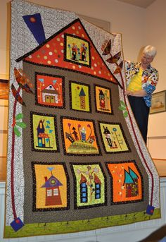 Welcome  to the May MRQG  Meeting!  Click Images to Enlarge:  Pam Ward & Joan Helzer  (Mother & Daughter) Collecting completed quilt bloc...