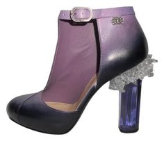 fall 2012 Chanel Ombre Leather Crystal Lucite Heel Cutout Booties Sz 39 Purple Pumps. Get the must-have pumps of this season! These Chanel Ombre Leather Crystal Lucite Heel Cutout Booties Sz 39 Purple Pumps are a top 10 member favorite on Tradesy. Save on yours before they're sold out!