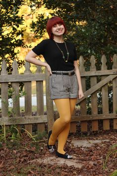 Fall Outfit: Black Short Sleeved Sweater, Houndstooth Shorts, and Yellow Tights
