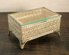 This listing is for an antique/vintage brass and beveled glass box. The box is retangular shaped and has its original gold velvet lining.