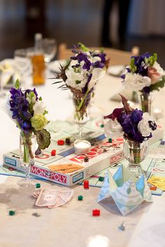 Tables named after board games used the games in the table decor. Planning by Filosophi Events. Photo by Contrast Studio.