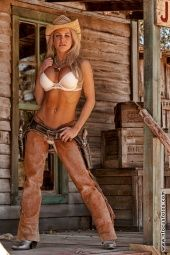 leather chaps cowgirl with gun